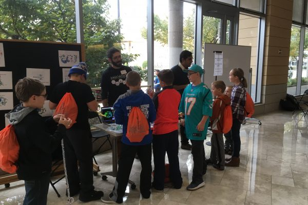 Students volunteering at the Wisconsin Science Festival
